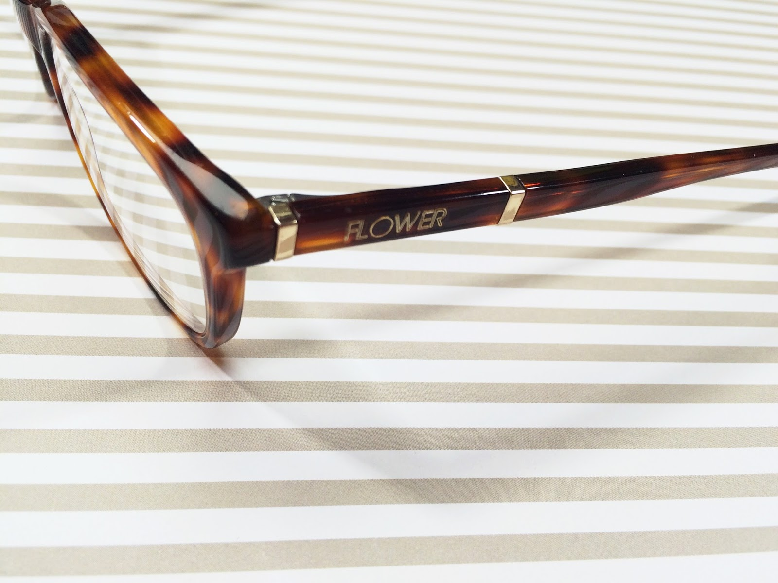 46d9523bb2 Each of the frames has the FLOWER logo in gold on the arms of the glasses.  They styles were different enough to tell them apart - some have thick  plastic ...