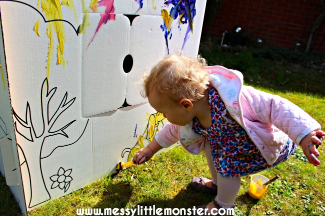 Outdoor painting activity for kids.  Paint a cardboard playhouse.