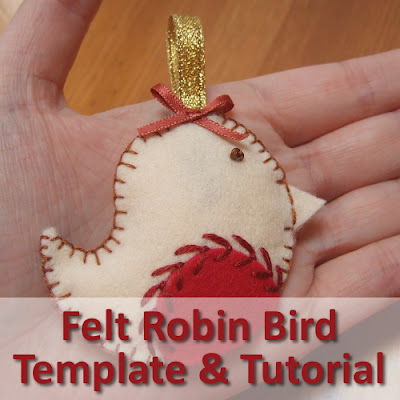 Robin bird made from craft felt with a gold ribbon for hanging on the tree