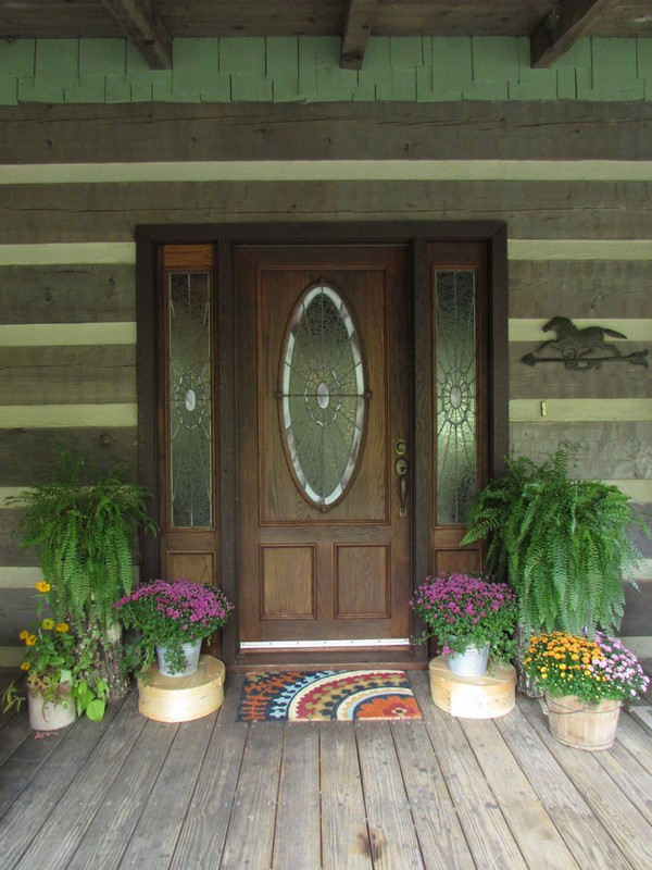 Log Cabin Home Porch for Fall with mums