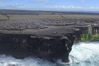 Cliff-top boulders on Ireland's Aran Islands, moved inland by recent storms. (Image Credit: Peter Cox) Click to Enlarge.