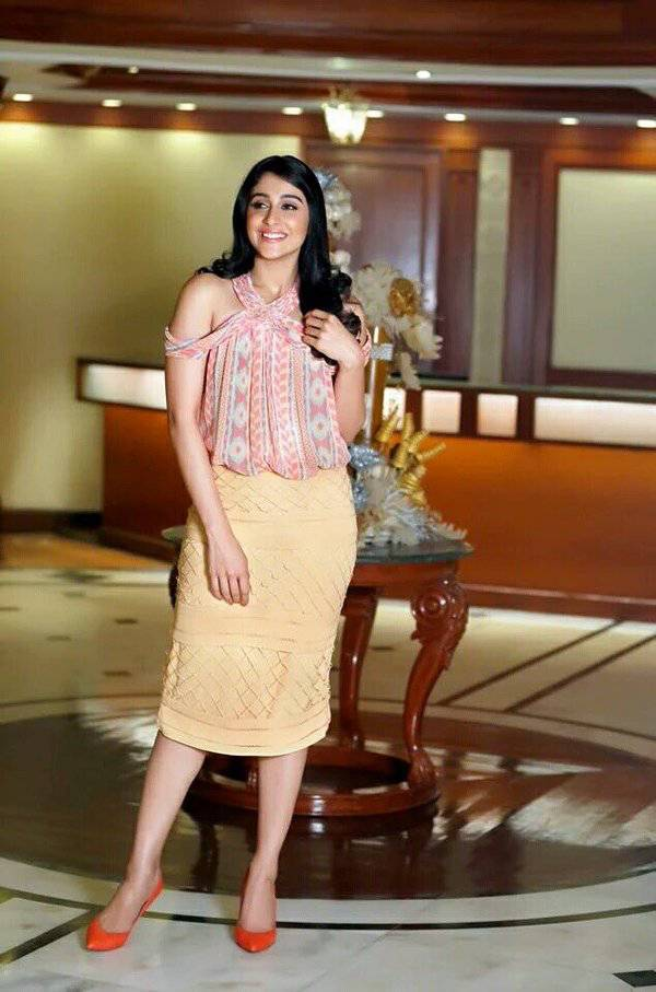 Beautiful Actress Regina Cassandra Photoshoot In Orange Dress