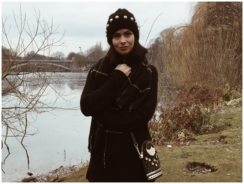 THE LAKE   June Gold wearing a black Gina Tricot dress, a black & Other Stories beanie and brown Panama Jack winter boots