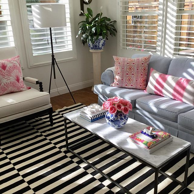 Cottage style living room with pops of pink - design by Kathy of Good Life of Design. Come see more in Spring Color: Spaces, Style & Sweets.