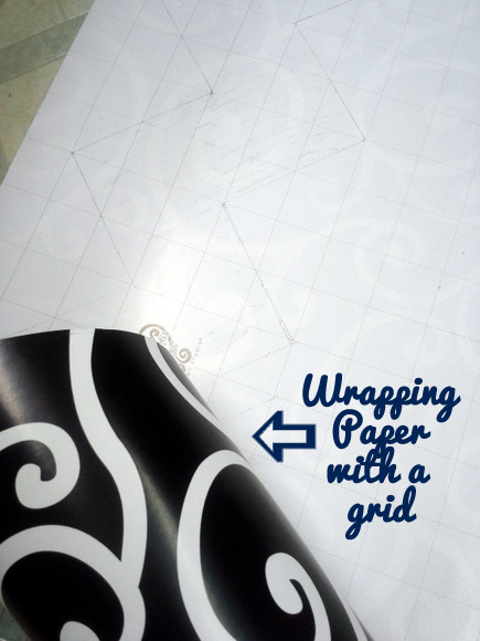 Life hack: use wrapping paper with a grid on the back as a chevron pattern template!
