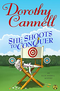 She Shoots to Conquer: An Ellie Haskell Mystery by Dorothy Cannell