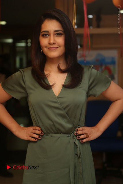 Actress Raashi Khanna Stills in Green Short Dress at Mirchi 95 Suno Aur Mercedes Jeeto Contest  0004.JPG