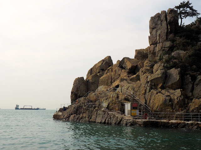 Rocky cliffs next to pebble beach in Taejongdae Park, Busan, South Korea