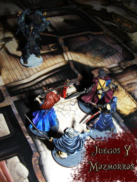 Imagen de las miniaturas de los supervivientes del juego Zombicide Black Plague y una miniatura de abominacion