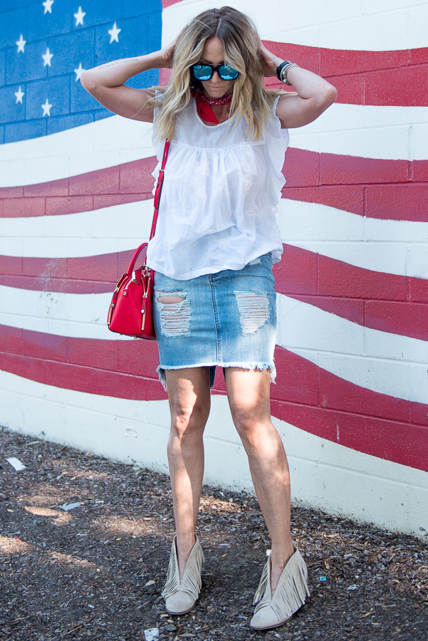 red scarf blue skirt white top