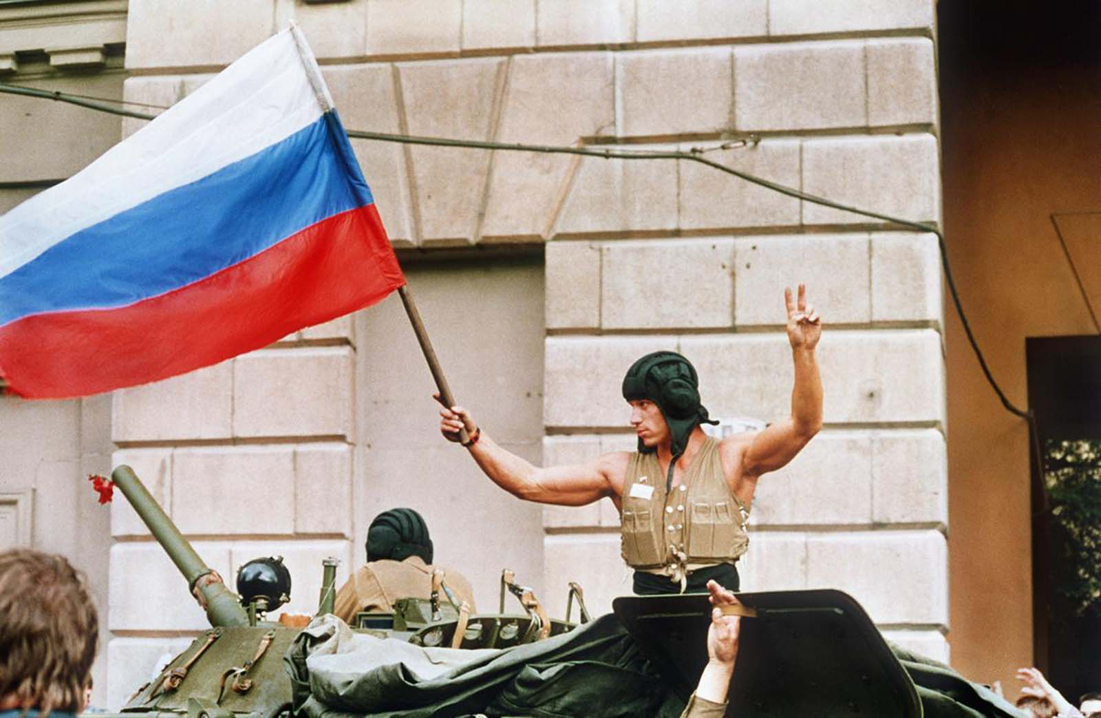 A soldier waves a Russian flag from the top of his tank as armored units leave their positions in Moscow following the collapse of the military coup against president Gorbachev on August 21, 1991. Coup leaders fled the capital and president Gorbachev was rumored to be returning soon.