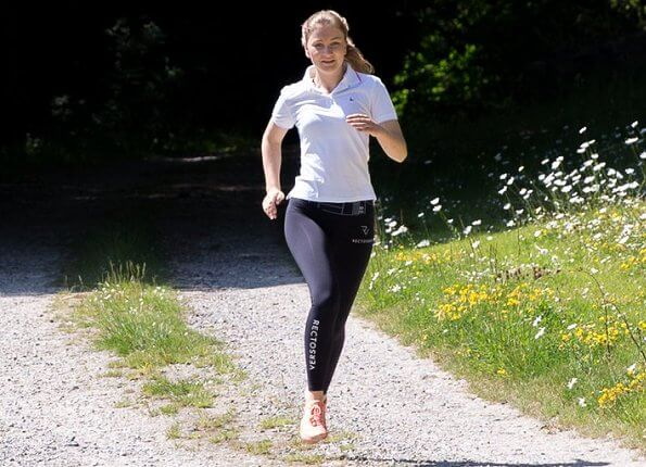 Princess Elisabeth in Recto Verso high-waist performance legging and  Nike pink air max trainers, white indigo polo shirt