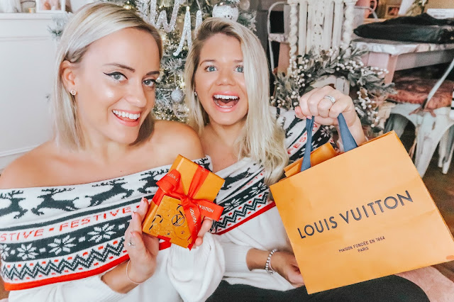 whitney and megan in christmas jumpers with louis vuitton
