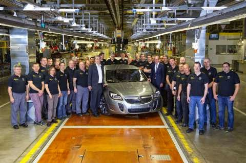 First Holden Insignia rolls of the line, workers pose with it
