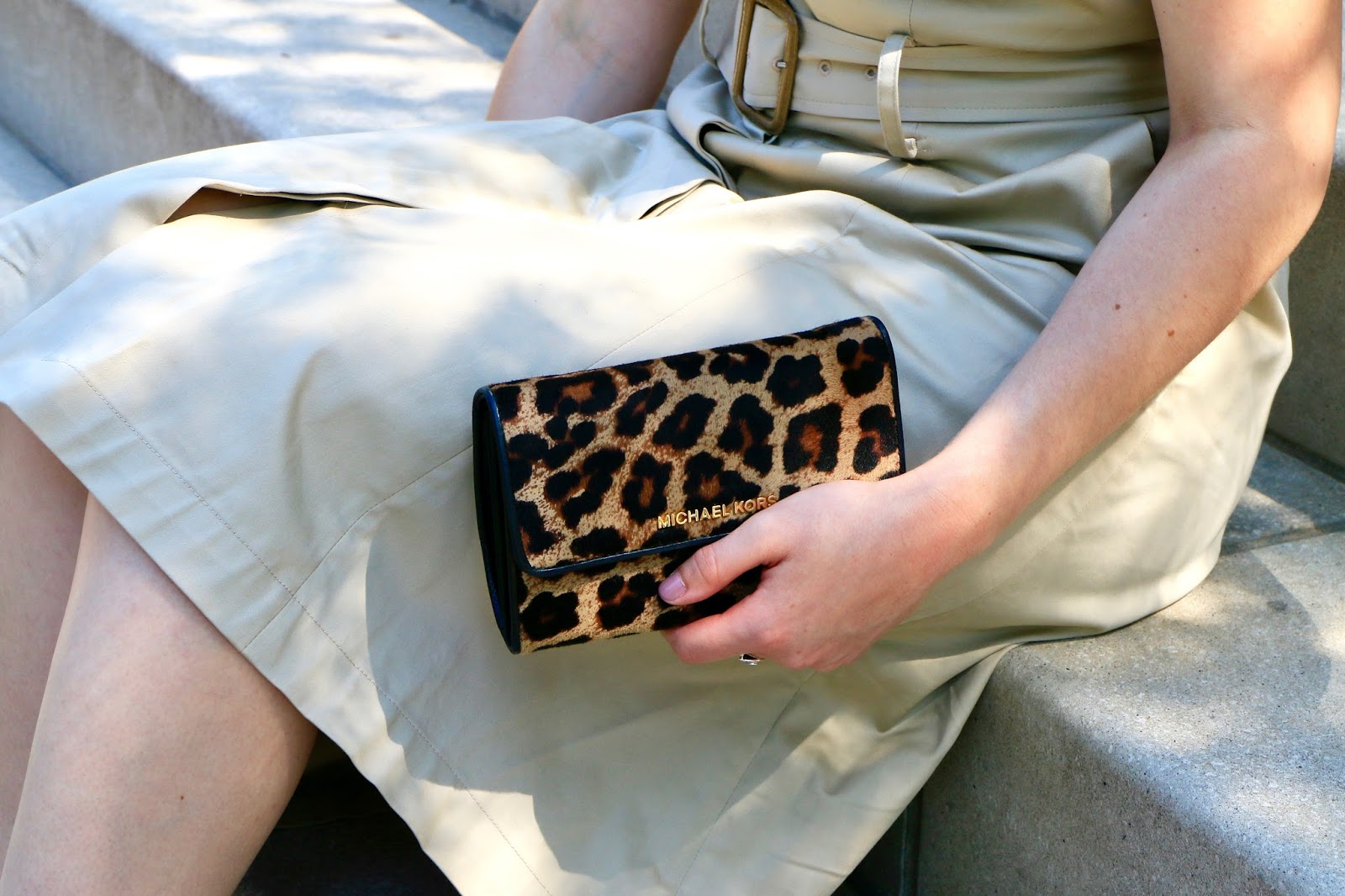 NYC Fashion blogger Kathleen Harper with a Michael Kors leopard clutch