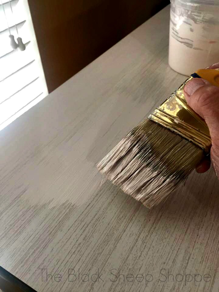 Apply a very thin base coat of Chalk Paint over laminate.