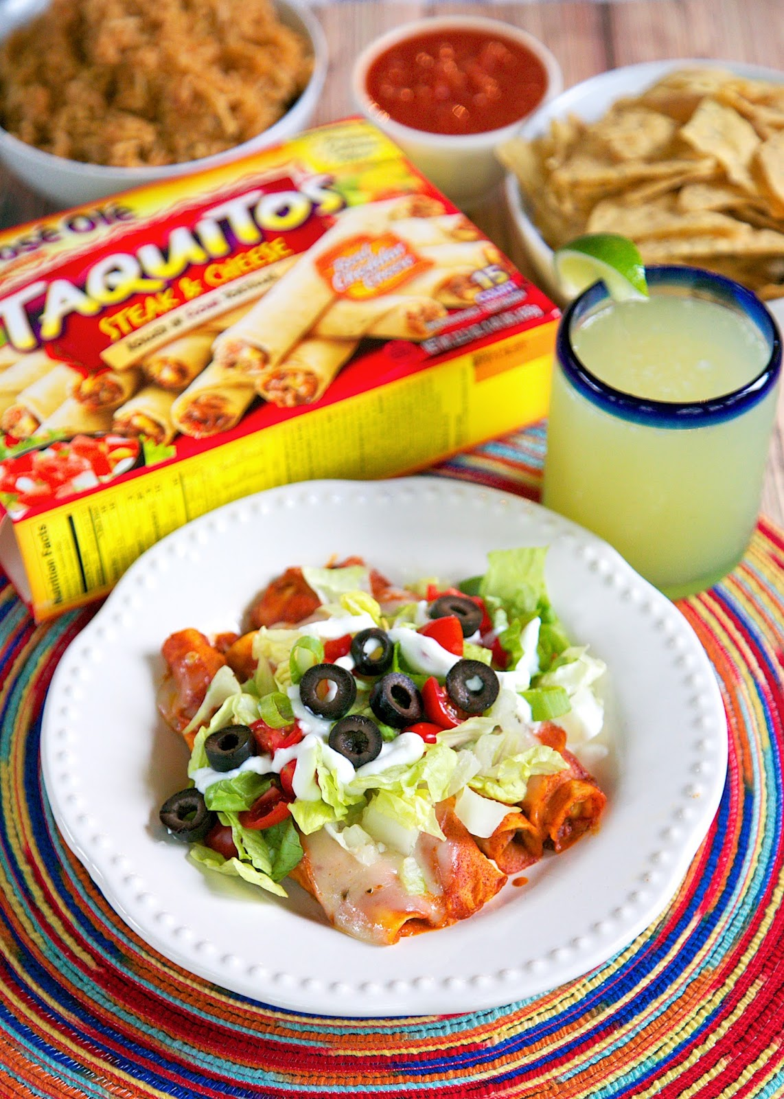 Taquito-lada Casserole Recipe - use frozen Jose Ole taquitos for a quick Mexican taquito enchilada casserole. Top with lettuce, tomatoes, olives, green onions and sour cream.