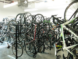 Vertical bike racks, filled to capacity in a bike storage room, Sunnyvale, California