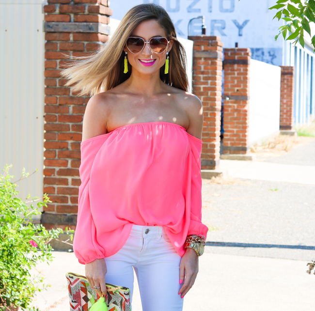 pom tassel clutch hot pink off the shoulder top white skinny jeans yellow tassel earrings