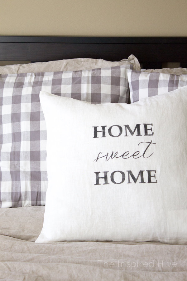 How to use Silhouette to make a DIY stenciled farmhouse style throw pillow.