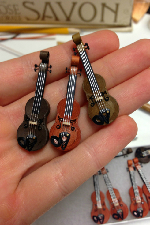 three quilled miniature violins