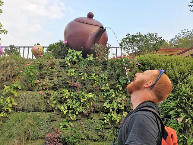 drinking from teapot fo guang shan buddha memorial kaohsiung taiwan