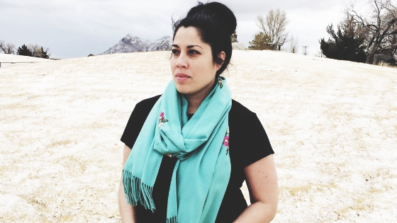 Viv wearing teal rose scarf at park in the Fall/Winter in Tonopah, NV