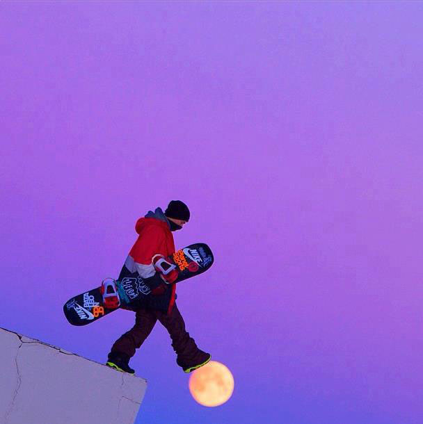 snowboarder walking on-moon