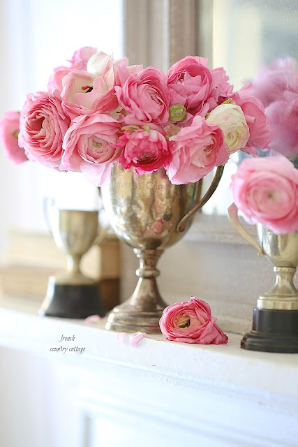 vintage silver trophy with ranunculus