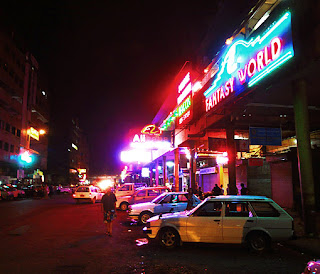 City Center and taxis at Thein Gyee Zay at night