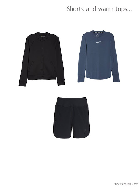 a sports outfit including a black jacket, blue long-sleeved top and black shorts