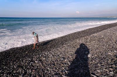 Luna La Union Local Coastal Stone Gatherer