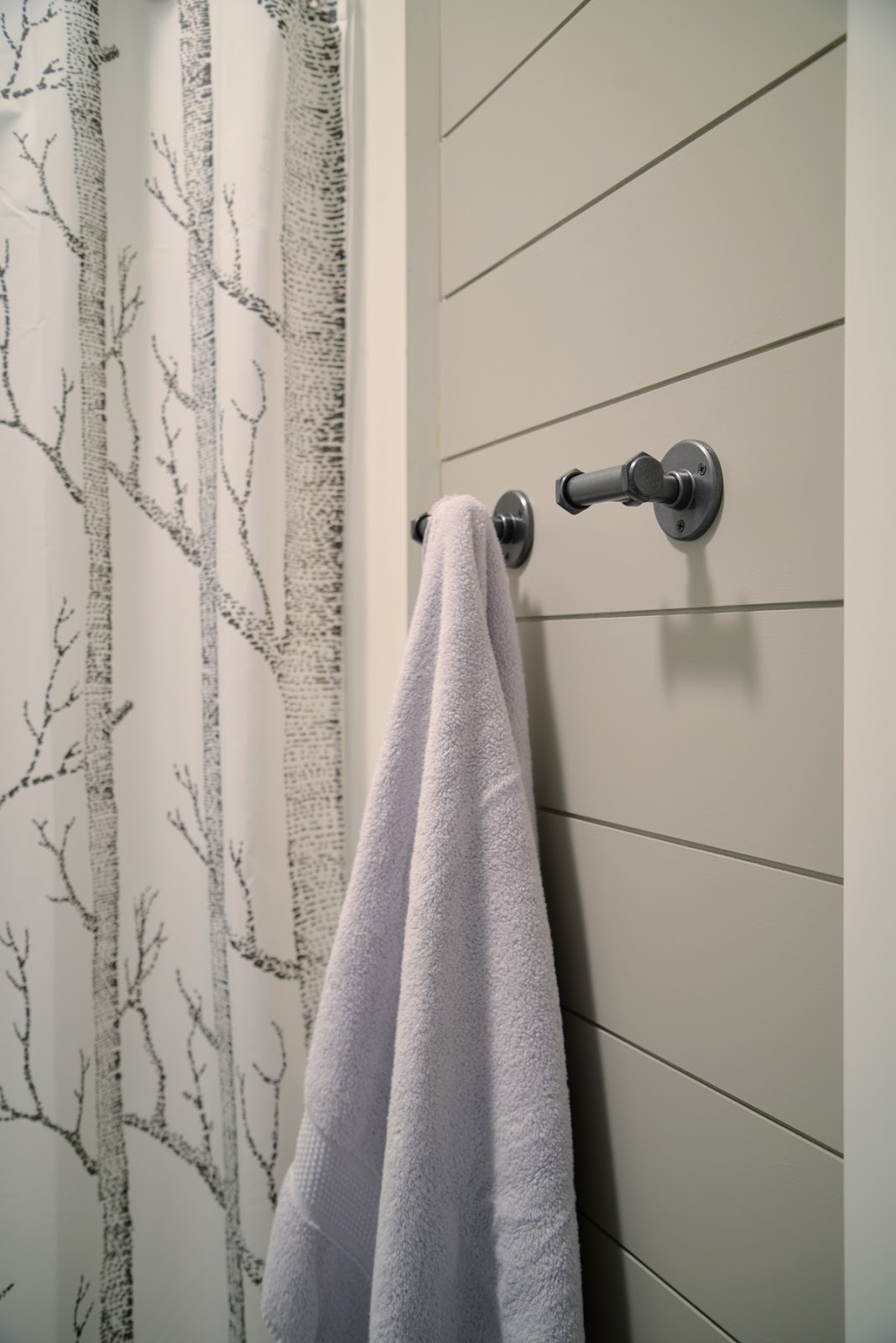 grey painted shiplap in the bathroom, industrial bathroom hardware | Ramblingrenovators.ca