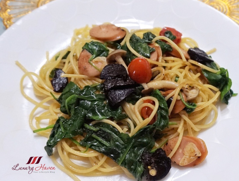exotic black garlic pasta with spinach sausage recipe