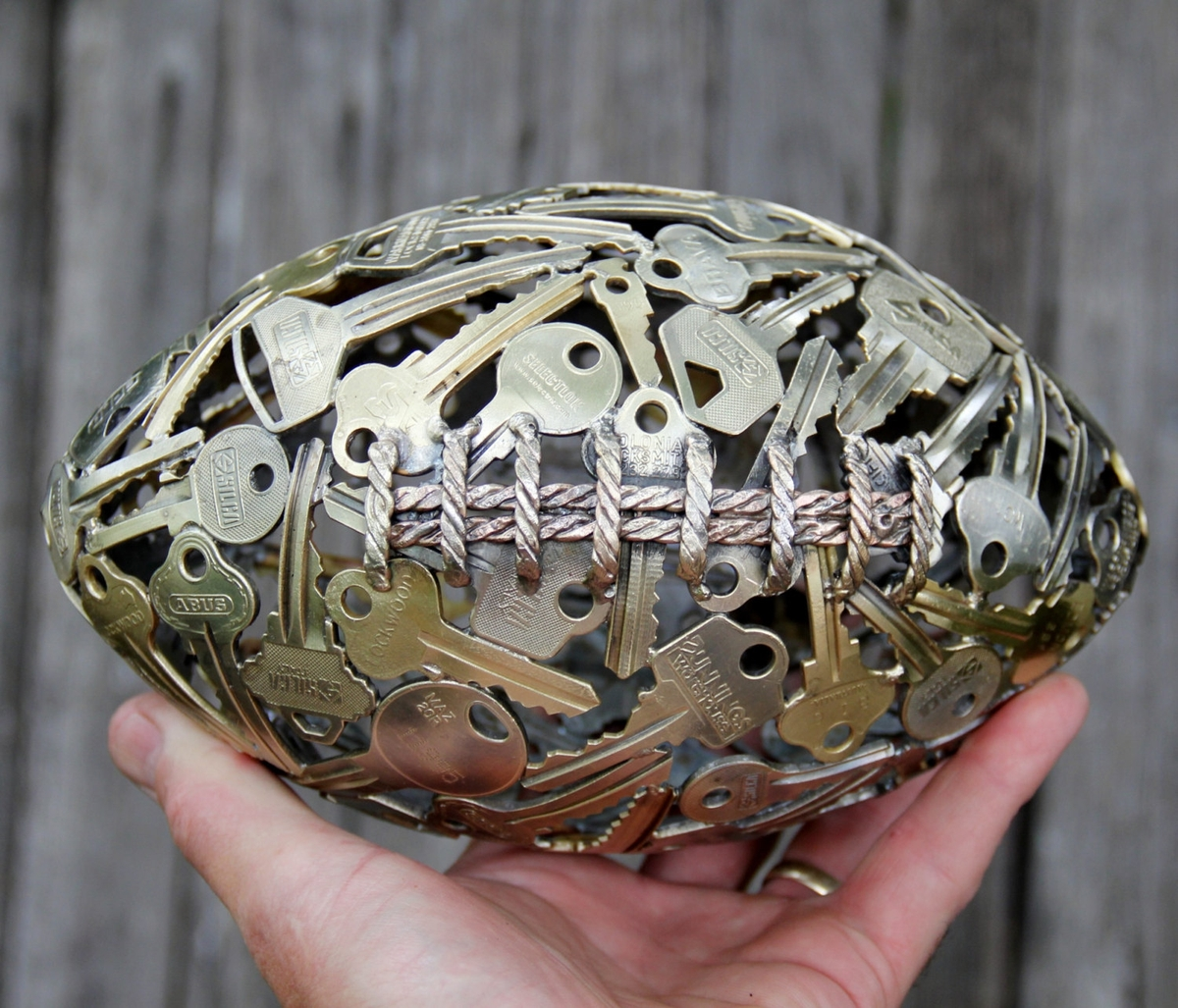 05-Small-NFL-American-Football-Michael-Moerkerk-Upcycling-Keys-to-make-sculptures-and-Accessories-www-designstack-co