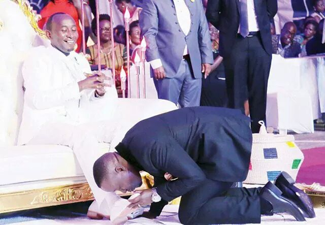 "Nothing new ""People bow down and kiss the ring of the Pope."" - Says top journalist who kissed shoes of Ugandan prophet"