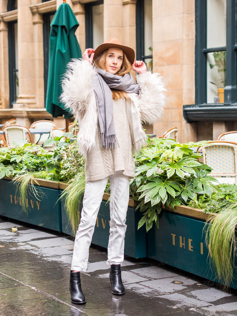 Light neutral coloured outfit and tan coloured wool hat H&M Premium Collection