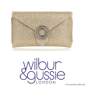 Kate Middleton carried Wilbur & Gussie Charlie gold glitter clutch