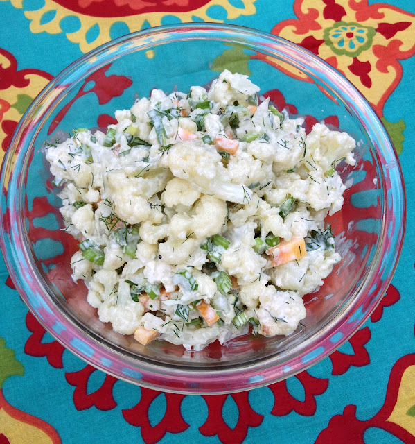 glass bowl filled with cauliflower salad