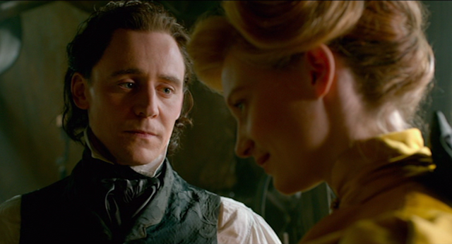 Thomas Sharpe (Tom Hiddleston) looks at Edith (Mia Wasikowska) with love in CRIMSON PEAK (2015).