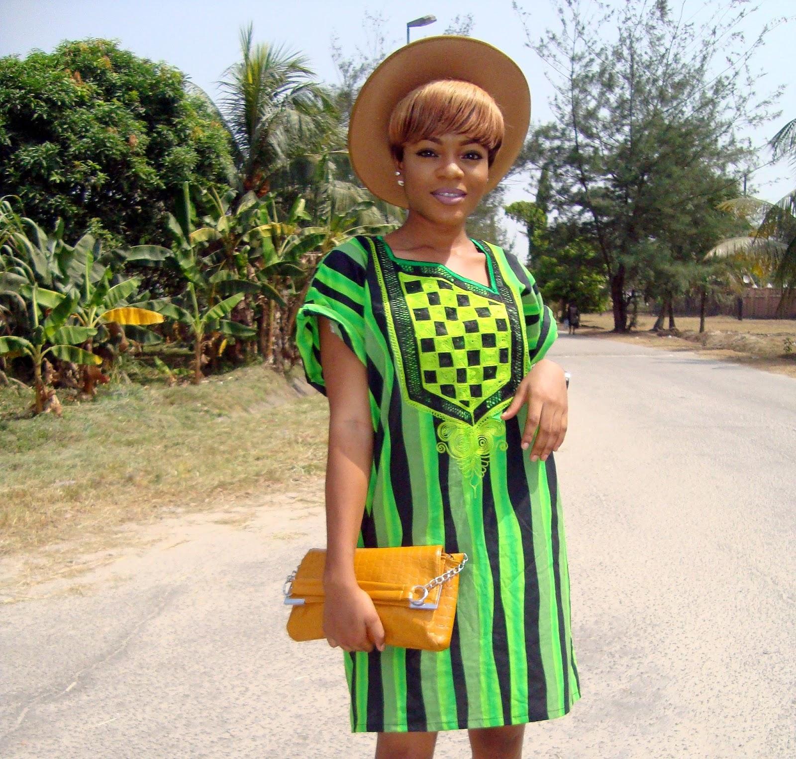 female agbada . green and black agbada, agbada dress