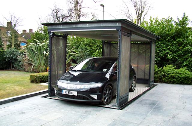 Garasi Single Dengan Bangunan Terpisah Di Taman Belakang Dan Menggunakan Lift Sehingga Bisa Terlihat Rata Dengan Lantai