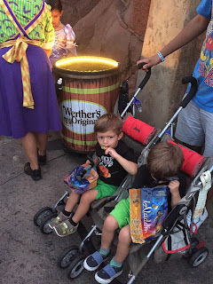 kids and candy at Mickeys Halloween party