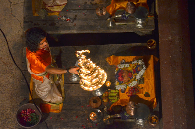 A Performer holding brass lamp during Ganga Aarti in Varanasi