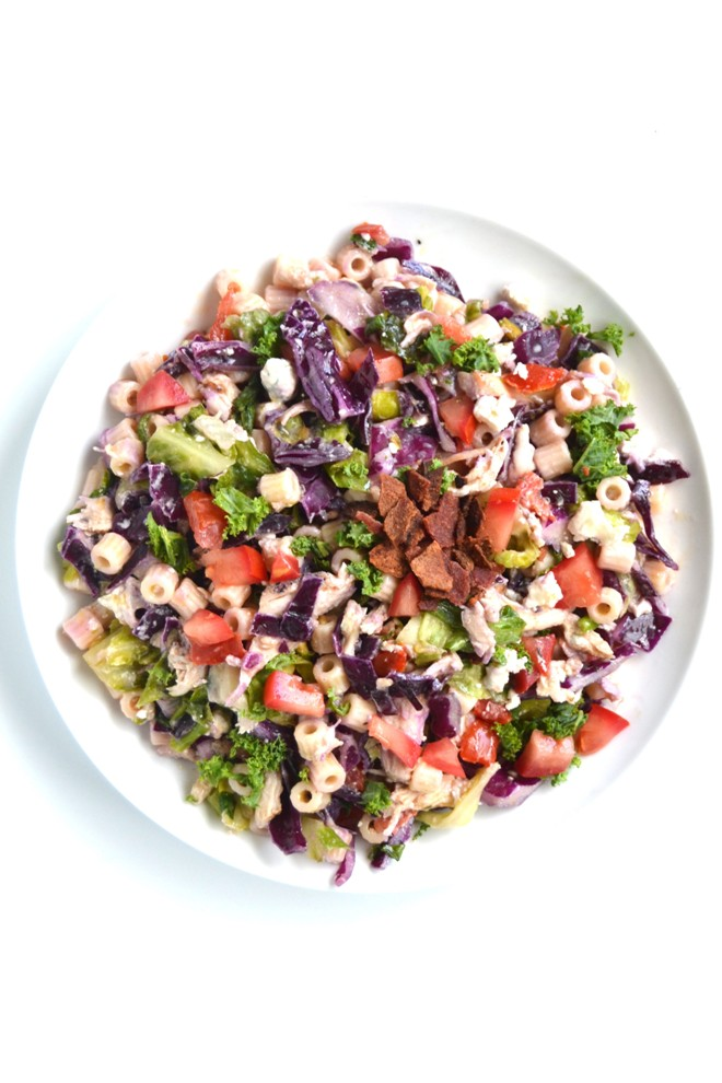 Blue Cheese Chopped Summer Salad is packed full of flavor and is the perfect salad for summer. Filled with crunchy red cabbage, creamy blue cheese and bacon, you won't be able to have just one bowl. www.nutritionistreviews.com