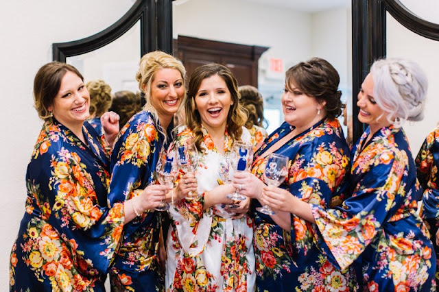 bridesmaids and bride in navy and yellow floral robes