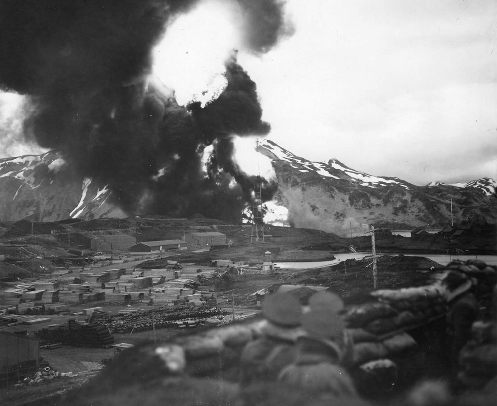 U.S. forces watch a massive fireball rise above Dutch Harbor, Alaska after a Japanese air strike in June of 1942.