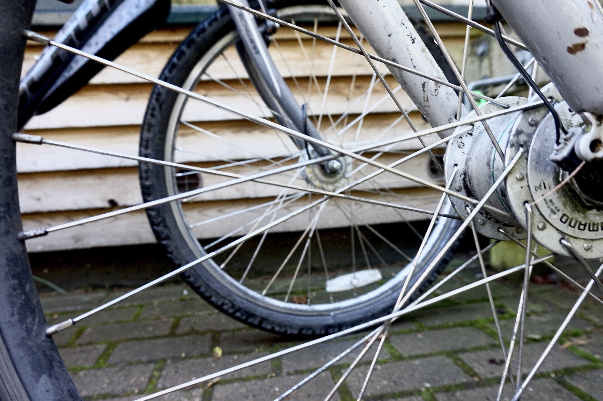 two bike wheels showing bike spokes