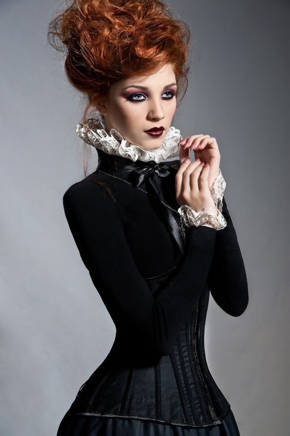 Women's Steampunk Victorian Gothic Couture clothing. Black velvet bodice with white lace collar and sleeves. Black corset with long bustle skirt with train. Steamgoth haute couture.