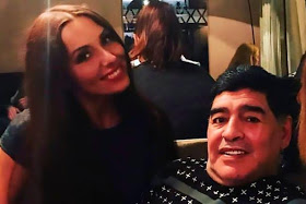 A Glamorous Russian journalist accuses Diego Maradona of forcibly removing her dress during interview